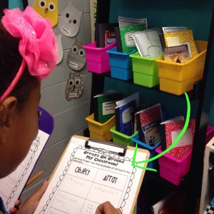 Are you teaching arrays right now? If so, check out my array freebie, where students hunt for examples for arrays in the classroom. These girls are using the book nooks to make an array